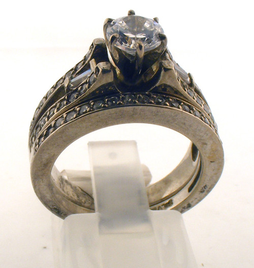 Ornate sterling silver and cz engagement style ring set. The cz total weight is .60ct + ctr. The total weight of the rings are 8.4 grams and is made for a finger size of 7.