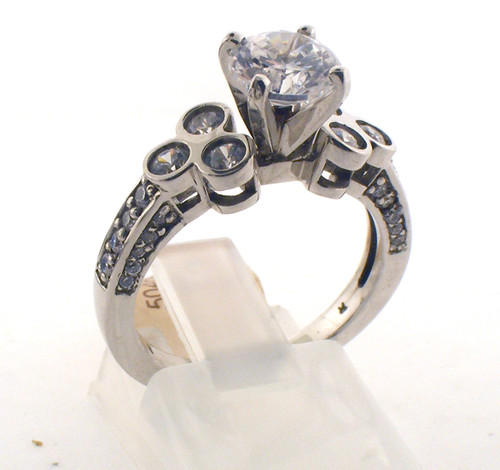 Ornate sterling silver and cz engagement style ring. The total weight of the ring is 3.9 grams and is made for a finger size of 6.75.