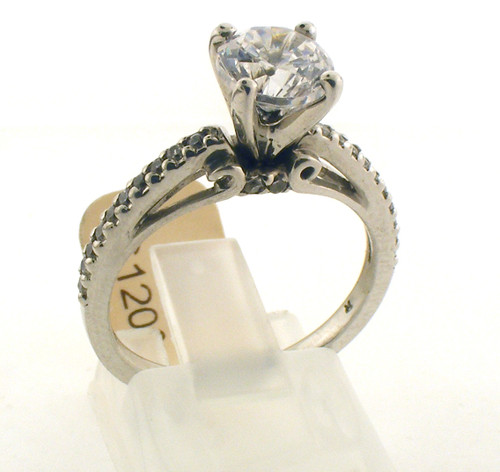 Ornate sterling silver and cz engagement style ring. The total weight of the ring is 2.8 grams and is made for a finger size of 7.