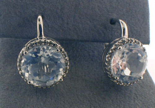 Sterling silver diamond and white topaz stud earrings. The total weight of the earrings are 5.6 grams.