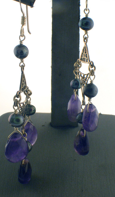 Sterling silver with pearl and purple stone drop earrings. The total weight of the earrings are 6 grams.