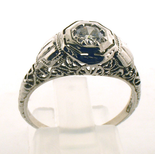 Vintage 18 karat white gold filigree and diamond ring. The diamond total weight is .21ct with color of H-I and a clarity of SI2. The total weight of the ring is 2.4 grams and is made for a finger size of 7.