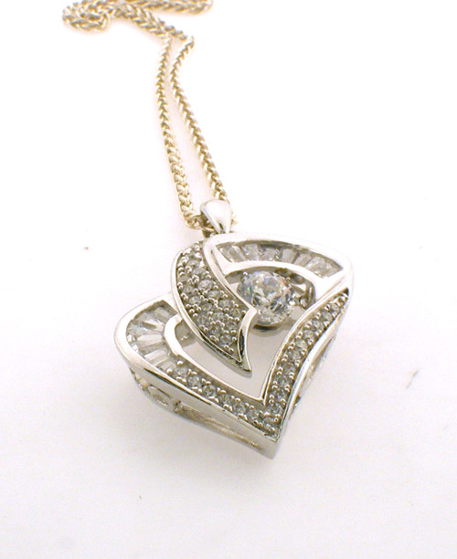 Sterling silver and CZ heart necklace. The total weight of the necklace is 4.4 grams and the total length of the chain is 18 inches.