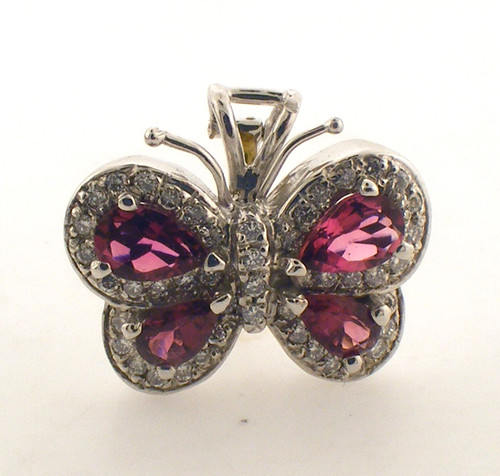 14 Karat white gold Diamond and ruby butterfly pendant. The Diamond TW is .25ct and the total weight of the pendant is 5 grams.