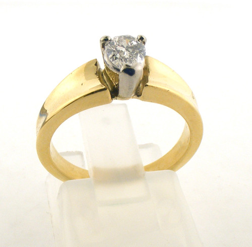 18 karat yellow gold and pear shape diamond ring. Diamond color is H-I and clarity is SI1, and is .35ct. The total weight of the ring is 5 grams and is made for a finger size of 5.25.