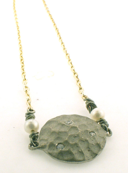 Two tone sterling silver necklace with a moon and CZ pendant. The total weight of the necklace is 3.0 grams and is 16 inches in length.