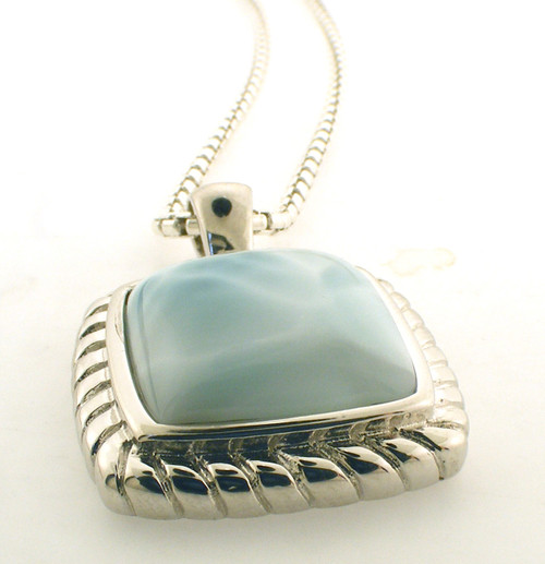Sterling silver and larimar necklace. The total weight of the necklace is 20.8 grams and is 22 inches in length.