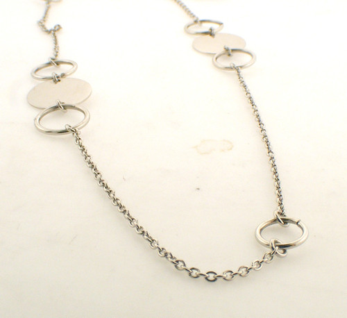 Sterling silver alternating polished and open disc necklace. The total weight of the necklace is 6.3 grams and the length is 35 inches.