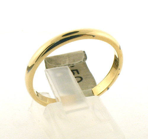 14 karat yellow gold wedding ring. The total weight of the ring is 3.6 grams and is made for a finger size of 11.