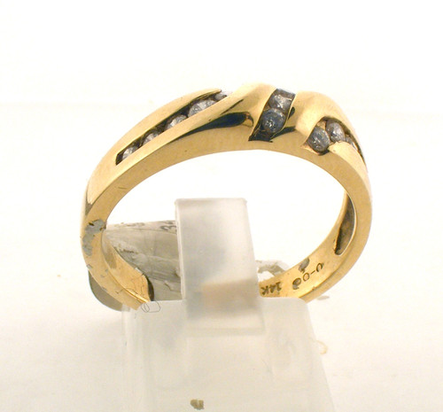 14 karat yellow gold and diamond wedding ring. The diamond TW is .34ct and the total weight of the ring is 5.9 grams. The ring is made for a finger size of 10.