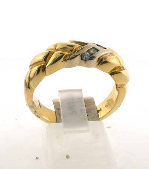 14 karat yellow gold and diamond wedding ring. The diamond TW is .17ct and the total weight of the ring is 8.1 grams. The ring is made for a finger size of 10.5.