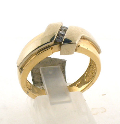 14 karat yellow gold and diamond wedding ring. The diamond TW is 1.2ct and the total weight of the ring is 10.1 grams. The ring is made for a finger size of 9.5.