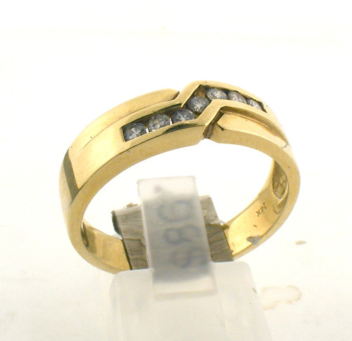 14 karat yellow gold and diamond wedding ring. The diamond TW is .25ct and the total weight of the ring is 5.9 grams. The ring is made for a finger size of 10.