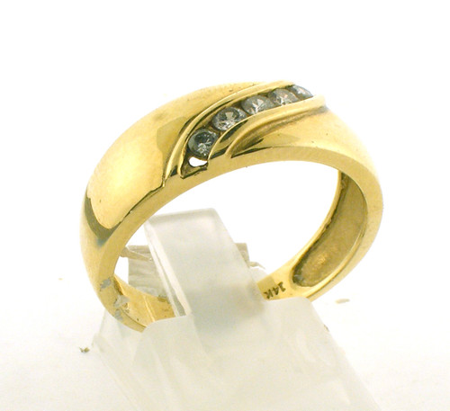 14 karat yellow gold and diamond wedding ring. The diamond TW is .30ct and the total weight of the ring is 5.1 grams. The ring is made for a finger size of 9.75.