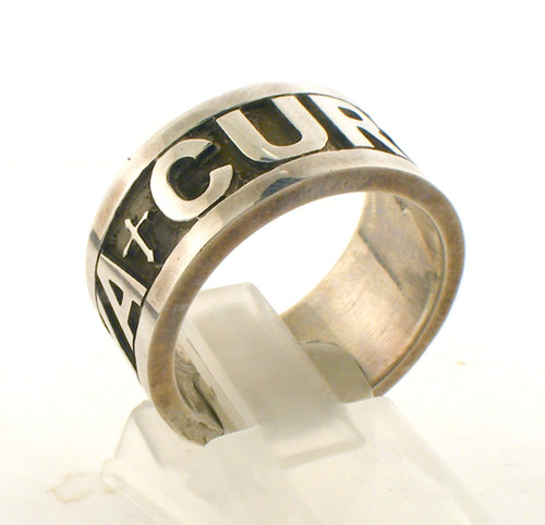"Sterling silver custom ""curtis kenya"" wedding band. The total weight of the ring is 4.3 grams and is made for a finger size of 7.75."