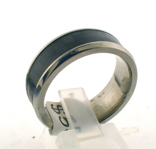 Titanium and carbon fiber wedding band. The total weight of the ring is 4.6 grams and is made for a finger size of 10.25.