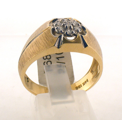 14 karat yellow gold and diamond ring. The dia TW is .25ct and the total weight of the ring is 5.8 grams. The ring is made for a finger size of 10.