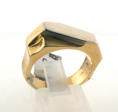 14 karat yellow gold ring. The total weight of the ring is 12.8 grams and the ring is made for a finger size of 8.5.