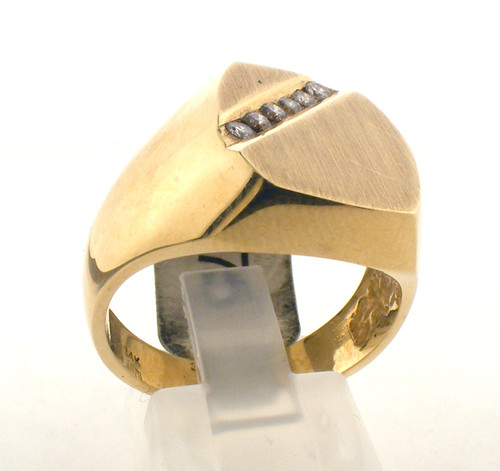 14 karat yellow gold and diamond ring. The dia TW is .18ct. The total weight of the ring is 11.0 grams and the ring is made for a finger size of 10.