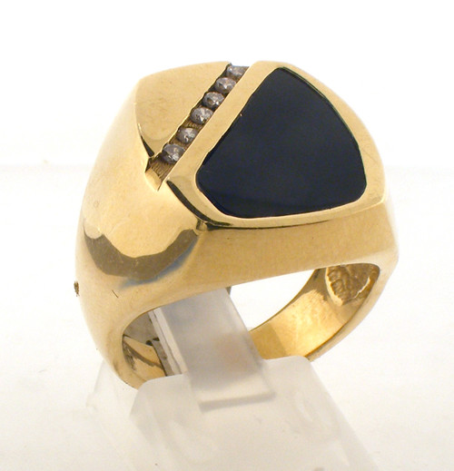 14 karat yellow gold diamond and black onyx ring. The dia TW is .15ct. The total weight of the ring is 14.5 grams and the ring is made for a finger size of 9.25.