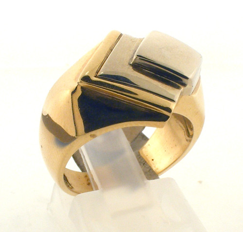 14 karat gold two tone ring. The total weight of the ring is 13.9 grams and the ring is made for a finger size of 6.75.