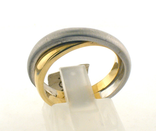 14 karat gold two tone overlapping ring. The total weight of the ring is 7.2 grams and is made for a finger size of 7.25.
