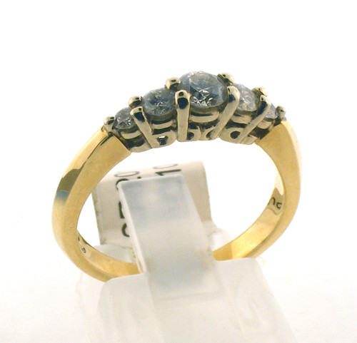 14 karat yellow gold and diamond wedding ring. The diamond TW is .50ct. The total weight of the ring is 3.9 grams and is made for a finger size of 7.25.