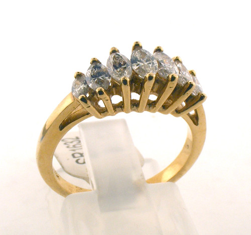 14 karat yellow gold and diamond wedding ring. The diamond TW is .87ct. The total weight of the ring is 3.5 grams and is made for a finger size of 6.