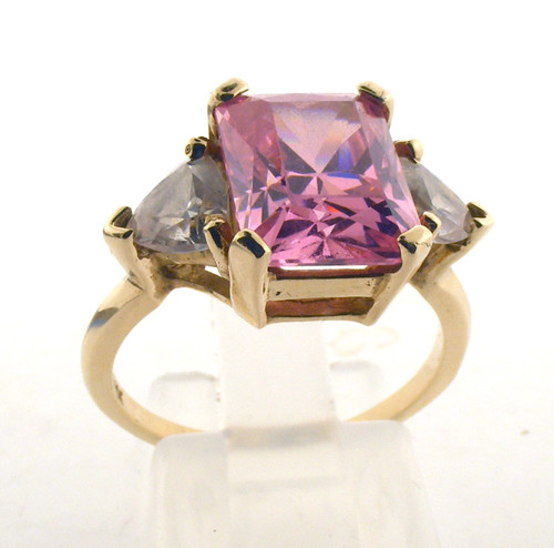 10 karat yellow gold pink cz ring. The total weight of the ring is 4.5 grams and is made for a finger size of 7.