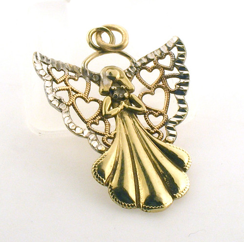10 karat gold and diamond angel. The total weight of the piece is .5 grams. This could be used as a pendant or charm.