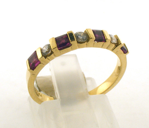 14 karat yellow gold diamond and ruby wedding ring. The diamond TW is .26ct and the ruby TW is .33ct. The total weight of the ring is 2.5 grams and is made for a finger size of 7.25.