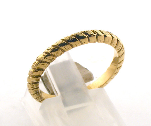 14 karat yellow gold braid cut wedding ring. The total weight of the ring is 2.6 grams and is made for a finger size of 6.25.