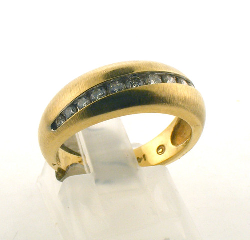 14 karat yellow gold and diamond wedding ring. The diamond TW is .33ct. The total weight of the ring is 4.6 grams and is made for a finger size of 6.25.