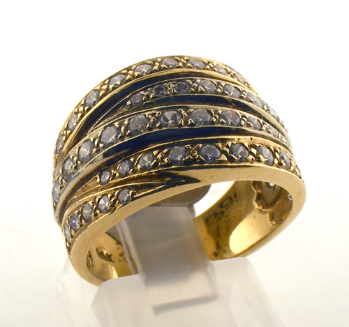 14 karat yellow gold and diamond wedding ring. The diamond TW is .88ct. The total weight of the ring is 8.0 grams and is made for a finger size of 6.75.