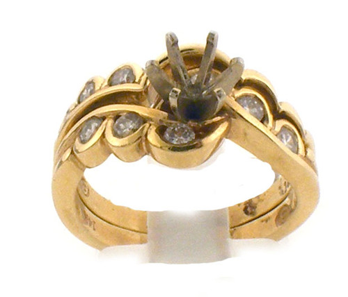 14 karat yellow gold and diamond wedding set. The diamond TW is .26ct. The total weight of both rings is 6.4 grams and is made for a finger size of 6.25. *Center stone sold separate*