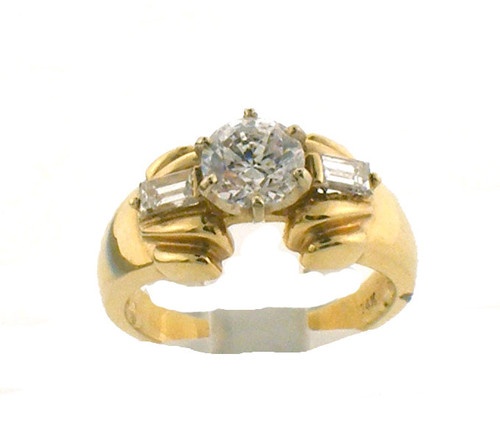 14 karat yellow gold and diamond engagement ring. The diamond TW is .18ct. Center stone is CZ but is exchangeable. The total weight of the ring is 4.9 grams and is made for a finger size of 6.5.