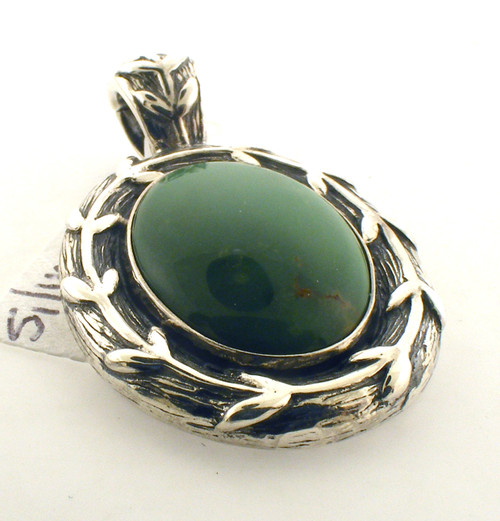 Sterling silver and green stone pendant. The total weight of the pendant is 9.9 grams.