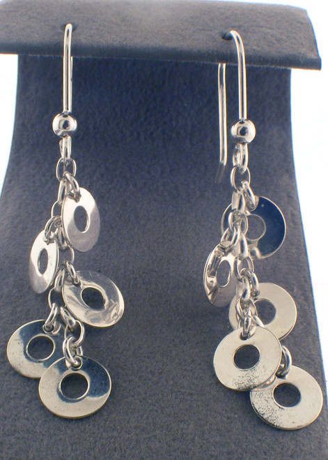 Sterling silver drop disc earrings. The total weight of the earrings are 3.0 grams.