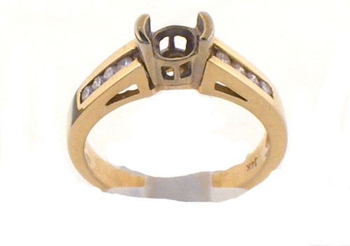 14 karat yellow gold and diamond engagement ring. The dia TW is .18ct and the total weight of the ring is 4.4 grams. This is made for a finger size of 7.