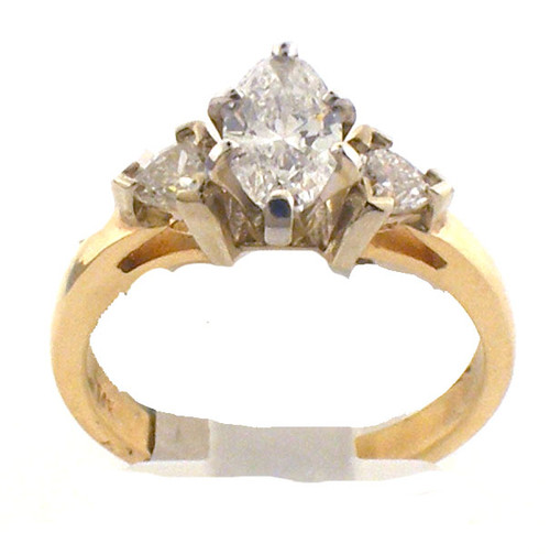 14 karat yellow gold and diamond engagement ring. The dia TW is .95ct., the color is G and the clarity is SI2. The total weight of the ring is 3.5 grams. This is made for a finger size of 6.25.