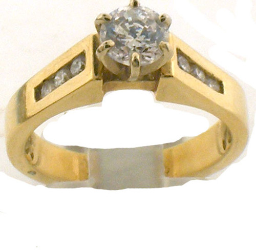 14 karat yellow gold and diamond engagement ring. Center stone is CZ. The Dia TW is .15ct. The total weight of the ring is 5.1 grams. This is made for a finger size of 6.25.
