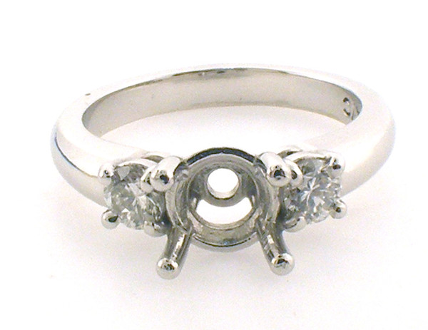 Platinum diamond Engagement  3 stone remount ring weighing 8.2 grams. Finger size 7.  Side diamond = .40ct TW H-I, VS2-SI1