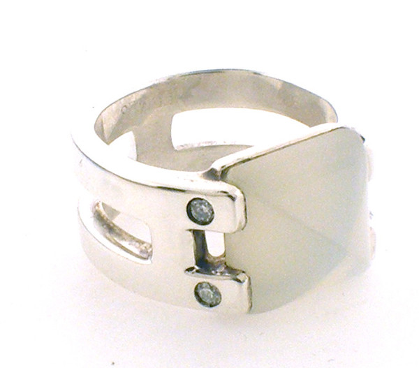 """Sterling Silver """"Hermes"""" moonstone and diamond H ring weighing10.0grams. Finger size 6"""