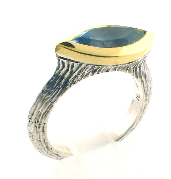 Sterling Silver and 18 karat yellow gold blue topaz ring. size 5