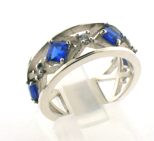 Sterling silver custom saraba simulated sapphire and cubic zirconia ring. Finger size 6.75.