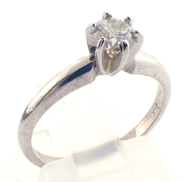 14 karat white gold diamond solitaire engagement ring weighing 2.1 grams. Finger size 5.75. Diamond = .43ct J I2