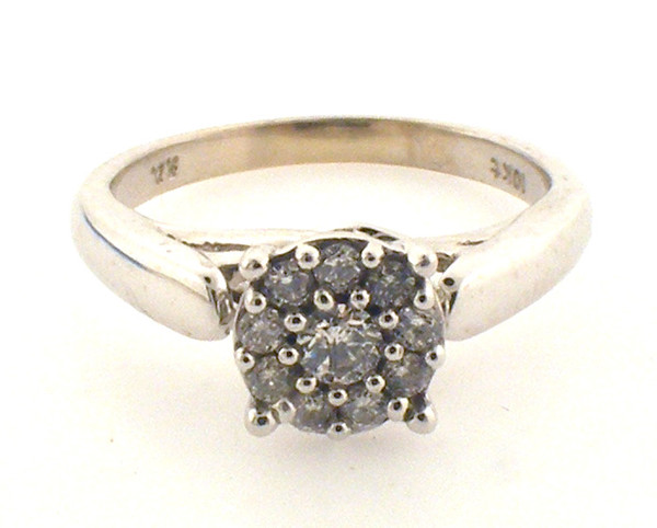 10 karat white gold diamond cluster ring weighing 3.0 grams. Diamonds weigh approx .20ct TW  H-I, SI2, Finger size 5