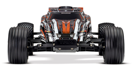 TRAXXAS Rustler®: 1/10 Scale Stadium Truck. Ready-To-Race with TQ 2.4GHz radio system and XL-5 ESC (fwd/rev). Includes: 7-Cell NiMH 3000mAh Traxxas® battery (Orange)