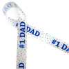 "#1 Dad printed in royal blue with primary colored polka dots printed on 7/8"" white single face satin ribbon."