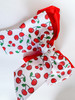 How sweet is this easy DIY hair bow made with our cherries ribbon and mixed with solid red?